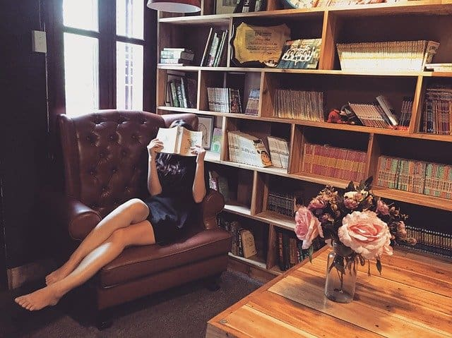 woman reading in personal library image